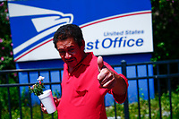 WEST NEW YORK, NJ - AUGUST 17: A man gesture as he pass by the United States Postal Service office on August 17, 2020 in West New York,  New Jersey. Mail Delays Fuel Concern Trump Is Undercutting Postal System before elections , Mail-in voting across the country has led to a series of anomalous results in recent weeks (Photo by Kena Betancur/ VIEWpress via Getty Images)