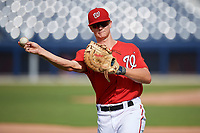 GCL Nationals first baseman Jackson Cramer (25) during warmups before the first game of a doubleheader against the GCL Mets on July 22, 2017 at The Ballpark of the Palm Beaches in Palm Beach, Florida.  GCL Mets defeated the GCL Nationals 1-0 in a seven inning game that originally started on July 17th.  (Mike Janes/Four Seam Images)