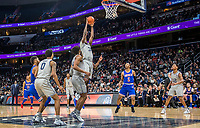 WASHINGTON, DC - DECEMBER 28: Qudus Wahab #34 of Georgetown collects a rebound. during a game between American University and Georgetown University at Capital One Arena on December 28, 2019 in Washington, DC.
