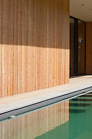 The walls of this modern house are clad ina natural pine