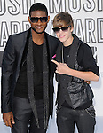 Usher & Justin Bieber at The 2010 MTV Video Music Awards held at Nokia Theatre L.A. Live in Los Angeles, California on September 12,2010                                                                   Copyright 2010  DVS / RockinExposures