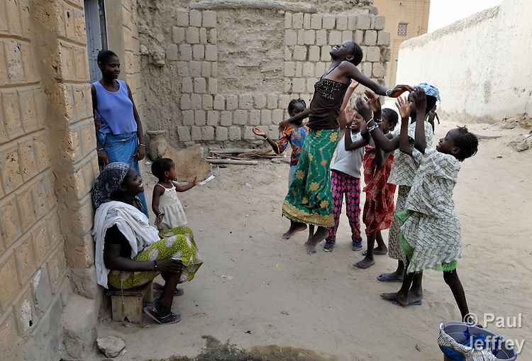 Girls playing in the street in Timbuktu, the northern Mali city that was seized by Islamist fighters in 2012 and then liberated by French and Malian soldiers in early 2013. During the jihadists' rule, women and girls were not allowed in public unless they were completely covered.