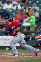 Oklahoma City RedHawks second baseman Jose Martinez (15) follows through on his swing during the Pacific Coast League baseball game against the Round Rock Express on July 9, 2013 at the Dell Diamond in Round Rock, Texas. Round Rock defeated Oklahoma City 11-8. (Andrew Woolley/Four Seam Images)