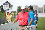 Gary McAllister (left) and Cao Weiyu (right) during the World Celebrity Pro-Am 2016 Mission Hills China Golf Tournament on 23 October 2016, in Haikou, Hainan province, China. Photo by Weixiang Lim / Power Sport Images