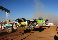 Apr 17, 2011; Surprise, AZ USA; LOORRS driver Nick Tyree (91) and Dow Woerner (33) during round 4 at Speedworld Off Road Park. Mandatory Credit: Mark J. Rebilas-