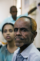 """Djibouti. Djibouti province. Djibouti. """"Oui à la vie"""" (Yes to life) was the first djiboutian association for seropositive people living with the HIV Aids disease. Portrait of his president and founder Mr. Ahmed Ali Moumin. Hair colored with henna. The Global Fund through the djiboutian Ministry of Health supports the programm with an Aids grant (financial aid).  © 2006 Didier Ruef"""