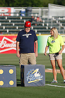 Myrtle Beach Pelicans fan Joel White playing the Big M Casino Dice game with Myrtle Beach Pelicans Senior Director of Community Development Jen Borowski during a game against the Potomac Nationals at Ticketreturn.com Field at Pelicans Ballpark on May 24, 2015 in Myrtle Beach, South Carolina. Potomac defeated Myrtle Beach 1-0. (Robert Gurganus/Four Seam Images)