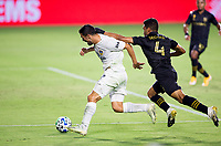 CARSON, CA - SEPTEMBER 06: Sebastian Lletget #17 of the Los Angeles Galaxy moves past Eddie Segura #4 of LAFC with the ball during a game between Los Angeles FC and Los Angeles Galaxy at Dignity Health Sports Park on September 06, 2020 in Carson, California.