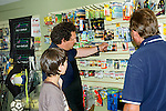Customers in fishing tackle sports shop<br />