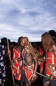 Lolgorian, Kenya. Siria Maasai; Eunoto ceremony; newly shaved moran wearing ceremonial cow hide cape.