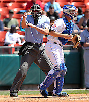 Home plate umpire Travis Carlson makes a call behind catcher Josh Thole during a game between the Columbus Clippers and Buffalo Bisons at Coca-Cola Field on May 31, 2012 in Buffalo, New York.  Columbus defeated Buffalo 3-0.  (Mike Janes/Four Seam Images)