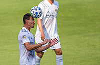 LOS ANGELES, CA - AUGUST 22: Daniel Steres #5 of the Los Angeles Galaxy heads a ball during a game between Los Angeles Galaxy and Los Angeles FC at Banc of California Stadium on August 22, 2020 in Los Angeles, California.