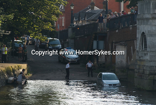 Richmond Upon Thames, Surrey, England 2007. Police rescue a car from the River Thames at high tide