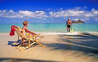 Senior retired couple enjoy the Hawaiian beach.