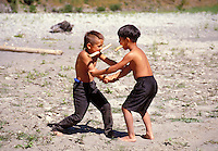 Yurok boys playing stickball on the beach at the Klamath river,  California