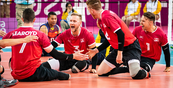 Austin Hinchey, Jesse Ward, Bryce Foster and Doug Learoyd, Lima 2019 - Sitting Volleyball // Volleyball assis.<br /> Canada competes for the bronze medal in men's Sitting Volleyball // Canada participe pour la médaille de bronze en volleyball assis masculin. 28/08/2019.