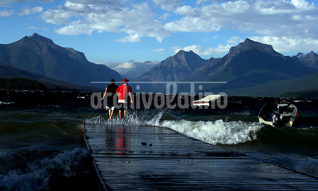 A couple is seen on a pier in Glacier National Park, Montana, USA, on July 24, 2007..Born in Argentina, photographer Ivan Pisarenko in 2005  decided to ride his motorcycle across the American continent. While traveling Ivan is gathering an exceptional photographic document on the more diverse corners of the region. Archivolatino will publish several stories by this talented young photographer..Closer look at  Ivan's page www.americaendosruedas.com...