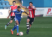 Dominic Samuel of Gillingham takes the ball past Exeter City's Rory McArdle during Gillingham vs Exeter City, Emirates FA Cup Football at the MEMS Priestfield Stadium on 28th November 2020