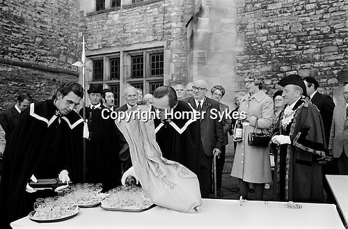 First Fruits Ceremony, Richmond, Yorkshire. England 1975.<br /> <br /> This ceremony links Richmond with its medieval origins, when the people were dependent on the success of each years harvest and the quality that the farmers produced. In medieval times, corn was grown on the three great open fields to the north of the town - Westfield, Gallowfield and Eastfield.<br /> Nowadays, after some introductory remarks by the Town Mayor, and thanks-giving prayers by a clergyman, a local farmer presents to the Mayor a small sack ful of newly threshed corn. This the Mayor hands over to a miller, who examines the corn, and when he passes favourable judgement on its quality, the Mayor presents the farmer with a bottle of wine. Other bottles are opened and the bystanders are invited to join in a toast to a good harvest.