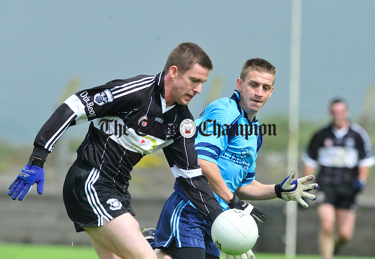 Conor Whelan of Doonbeg breaks under pressure from Cooraclare's Gearoid Meade. Photograph by Declan Monaghan