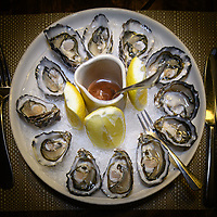 Melbourne, June 30, 2018 - Open to order oysters at Philippe Restaurant in Melbourne, Australia. Photo Sydney Low