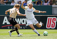 LA Sol's Christie Welsh sends a ball past FC Gold Pride defender Rachel Buehler. The LA Sol defeated FC Gold Pride of the Bay Area 1-0 at Home Depot Center stadium in Carson, California on Sunday April 19, 2009.  ..  .
