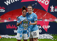 1st November 2020; Wembley Stadium, London, England; Womens FA Cup Final Football, Everton Womens versus Manchester City Womens; Demi Stokes and Rose Lavelle of Manchester City pose with the Womens FA Cup Final Trophy