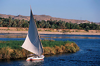 Felucca sailing on the waters of the Nile River, Aswan, Egypt.