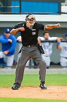 Home plate umpire Ronnie Whiting calls a batter out on strikes during the Appalachian League game between the Greeneville Astros and the Burlington Royals at Burlington Athletic Park on July 1, 2013 in Burlington, North Carolina.  The Astros defeated the Royals 7-0 in Game One of a doubleheader.  (Brian Westerholt/Four Seam Images)