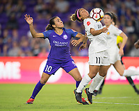 Orlando, FL - Saturday March 24, 2018: Utah Royals midfielder Desiree Scott (11) settles the ball off her chest while defended by Orlando Pride forward Marta Vieira da Silva (10) during a regular season National Women's Soccer League (NWSL) match between the Orlando Pride and the Utah Royals FC at Orlando City Stadium. The game ended in a 1-1 draw.