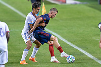 CHICAGO, UNITED STATES - AUGUST 25: Fabian Herbers #21 of Chicago Fire battles with Yuya Kubo #7 of FC Cincinnati during a game between FC Cincinnati and Chicago Fire at Soldier Field on August 25, 2020 in Chicago, Illinois.