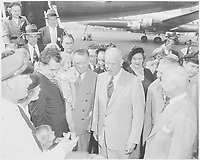 Richard and Pat Nixon introduce General Dwight D. Eisenhower—Richard Nixon's running mate—to their daughters Tricia (standing) and Julie (carried by her father), Washington National Airport, September 10, 1952.<br /> <br /> PHOTO : Abbie Rowe