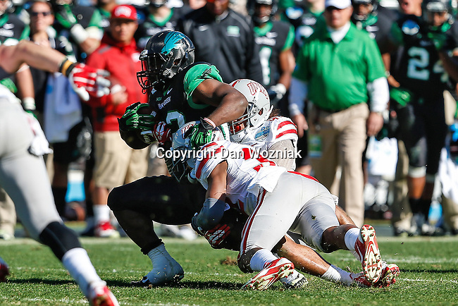 North Texas Mean Green wide receiver Brelan Chancellor (3) and UNLV Rebels defensive back Mike Horsey (32) in action during the Heart of Dallas Bowl game between the North Texas Mean Green and the UNLV Rebels at the Cotton Bowl Stadium in Dallas, Texas. UNT defeats UNLV 36 to 14.