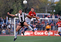Damien Mori (AC) fights with (MK)<br /> Grand Final - Adelaide City vs Melbourne Knights<br /> 1992 Coca Cola National Soccer League<br /> May 3rd 1992 / Olympic Park - Melbourne<br /> © Sport the library / Ian Kenins