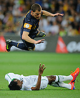 James TROISI (11) of Australia jumps over Kamel AL MOUSA (7) of Saudi Arabia during the FIFA 2014 World Cup Group D Asian Qualifier match between Australia and Saudi Arabia at AAMI Park in Melbourne, Australia...This image is not for sale on this web site. Please contact Southcreek Global Media for licensing:.Toll Free: 1.800.934.5030.Canada: 701 Rossland Rd. East, Suite 315, Whitby, Ontario, Canada, L1N 9K3.USA: 10792 Baron Dr, Parma OH, USA 44130.Web: http://southcreekglobal.net/ and http://southcreekglobal.com/