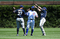 Chicago Cubs third baseman Luis Valbuena (24) jokes with Carlos Gomez (27) and Gerardo Parra (28) before a game against the Milwaukee Brewers on August 14, 2014 at Wrigley Field in Chicago, Illinois.  Milwaukee defeated Chicago 6-2.  (Mike Janes/Four Seam Images)