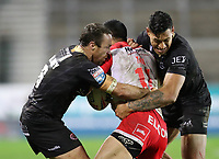20th November 2020; Totally Wicked Stadium, Saint Helens, Merseyside, England; BetFred Super League Playoff Rugby, Saint Helens Saints v Catalan Dragons; James Maloney and Israel Folau of Catalan Dragons tackle Zeb Taia of St Helens