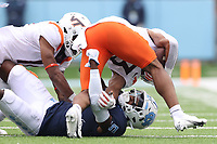 CHAPEL HILL, NC - OCTOBER 10: Braxton Burmeister #3 of Virginia Tech is tackled by Patrice Rene #5 of North Carolina during a game between Virginia Tech and North Carolina at Kenan Memorial Stadium on October 10, 2020 in Chapel Hill, North Carolina.