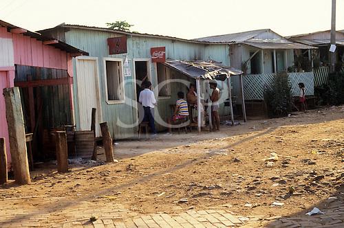 Ipixuna River, Acre, Amazon, Brazil. 'Caboclo (riberinho)' settlement; Bar 4 Irmaos cafe bar with Coca Cola advertisement.