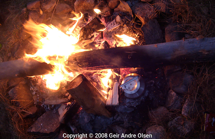 Campfire and coffee at hiking-trip in the Norwegian Forrest this fall