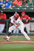 Peoria Chiefs center fielder Magneuris Sierra (34) attempts to bunt during a game against the Dayton Dragons on May 6, 2016 at Dozer Park in Peoria, Illinois.  Peoria defeated Dayton 5-0.  (Mike Janes/Four Seam Images)