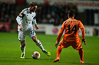 Thursday 28 November  2013  Pictured: ( L-R )  Angel Rangel tries to get the ball past Juan Bernat of Valencia<br /> Re:UEFA Europa League, Swansea City FC vs Valencia CF  at the Liberty Staduim Swansea