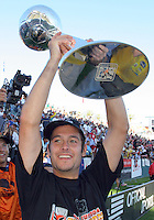 D.C. United's Mike Petke holds the MLS Cup after defeating the Kansas City Wizards 3-2 at the Home Depot Center, in Carson, Calif., Sunday, Oct. 14, 2004.