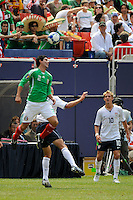 Jonny Magallon (2) of Mexico (MEX) plays a header. Mexico (MEX) defeated the United States (USA) 5-0 during the finals of the CONCACAF Gold Cup at Giants Stadium in East Rutherford, NJ, on July 26, 2009.