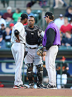 Louisville Bats Pitcher Aroldis Chapman (51) talks with catcher Wilkin Castillo and pitching coach Ted Power during a game vs. the Rochester Red Wings Friday, May 14, 2010 at Frontier Field in Rochester, New York.   Rochester defeated Louisville by the score of 13-4.  Photo By Mike Janes/Four Seam Images