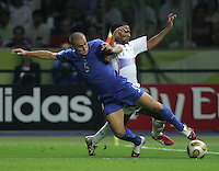 Italian defender (5) Fabio Cannavaro tackles the ball away from French midfielder (7) Florent Malouda. Italy defeated France on penalty kicks after leaving the score tied, 1-1, in regulation time in the FIFA World Cup final match at Olympic Stadium in Berlin, Germany, July 9, 2006.