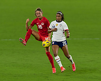 ORLANDO CITY, FL - FEBRUARY 18: Janine Beckie #16 settles the ball while pressured by Margaret Purce #20 during a game between Canada and USWNT at Exploria stadium on February 18, 2021 in Orlando City, Florida.