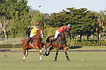 WELLINGTON, FL - NOVEMBER 25:  Julio Arellano of Team USA (Red) controls the ball towards the goal post, as Team USA defeats Team Brazil, 9 - 7 in the USPA International Cup final, at the Grand Champions Polo Club, on November 25, 2017 in Wellington, Florida. (Photo by Liz Lamont/Eclipse Sportswire/Getty Images)