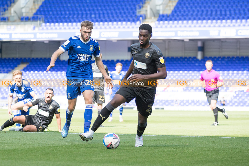 Emeka Obi, Wigan Athletic,  clears from danger during Ipswich Town vs Wigan Athletic, Sky Bet EFL League 1 Football at Portman Road on 13th September 2020
