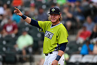Dash Winningham of the Columbia Fireflies acknowledges the cheers of the crowd as he is introduced before the first round of the Home Run Derby as part of of the South Atlantic League All-Star Game festivities on Monday, June 19, 2017, at Spirit Communications Park in Columbia, South Carolina. (Tom Priddy/Four Seam Images)